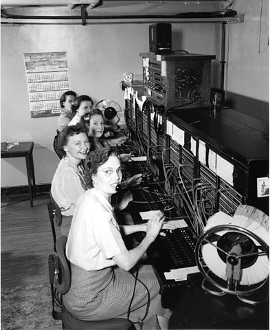 """Telephone operators, 1952"" by Seattle Municipal Archives from Seattle, WA - Telephone operators, 1952. Licensed under Creative Commons Attribution 2.0 via Wikimedia Commons - http://commons.wikimedia.org/wiki/File:Telephone_operators,_1952.jpg#mediaviewer/File:Telephone_operators,_1952.jpg"