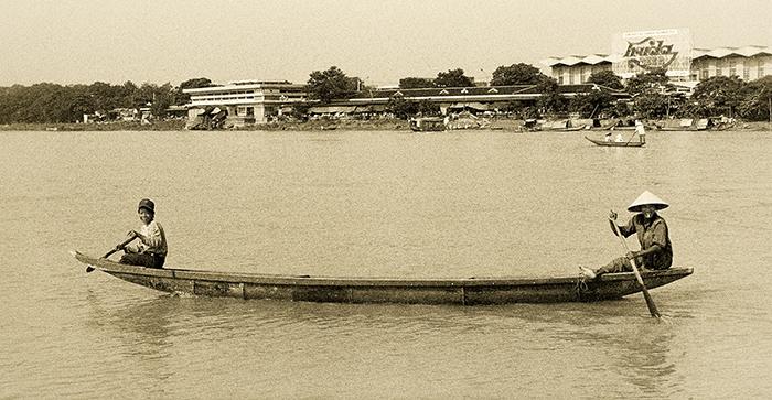 Fishermen on the river Perfume, Vietnam